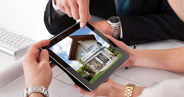 realtor displays properties to clients on mobile device