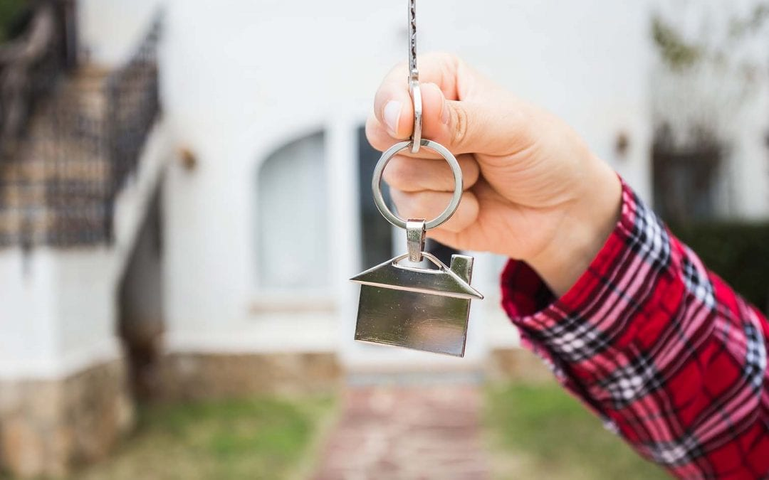 real estate workshop photo of homeowner hand with house key